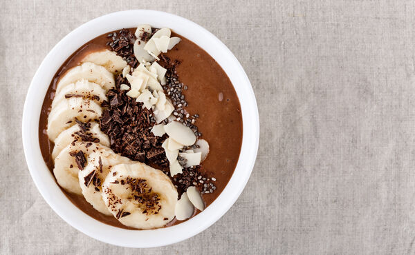 Banana chocolate smoothie bowl with peanut butter