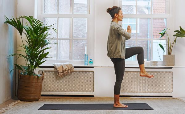 Warm up and unwind before your run with this yoga sequence
